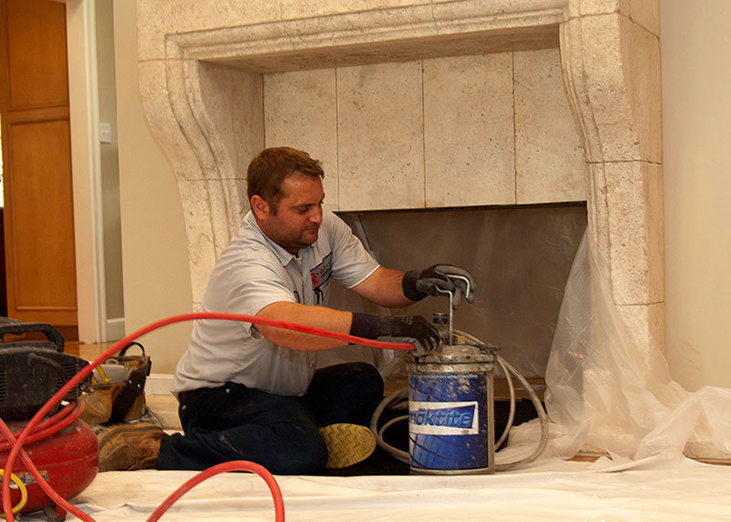 Our factory trained and certified technician applies several layers of sealant to the walls of the flue.